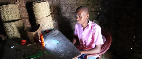 Providing 2,000 Kenyan school children with solar lights to do their homework at night.